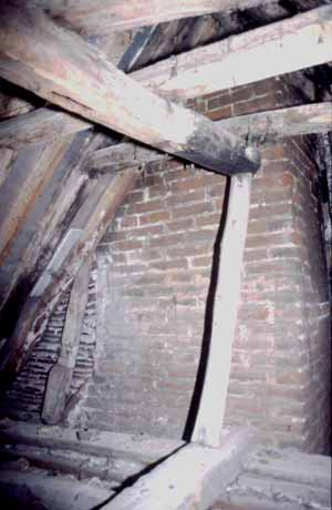 Illus. 8 Evidence of a smoke bay to the rear of the 16th century parlour. Note the sooted end of the collar purlin beyond the removed partition (truncated by the later chimney).